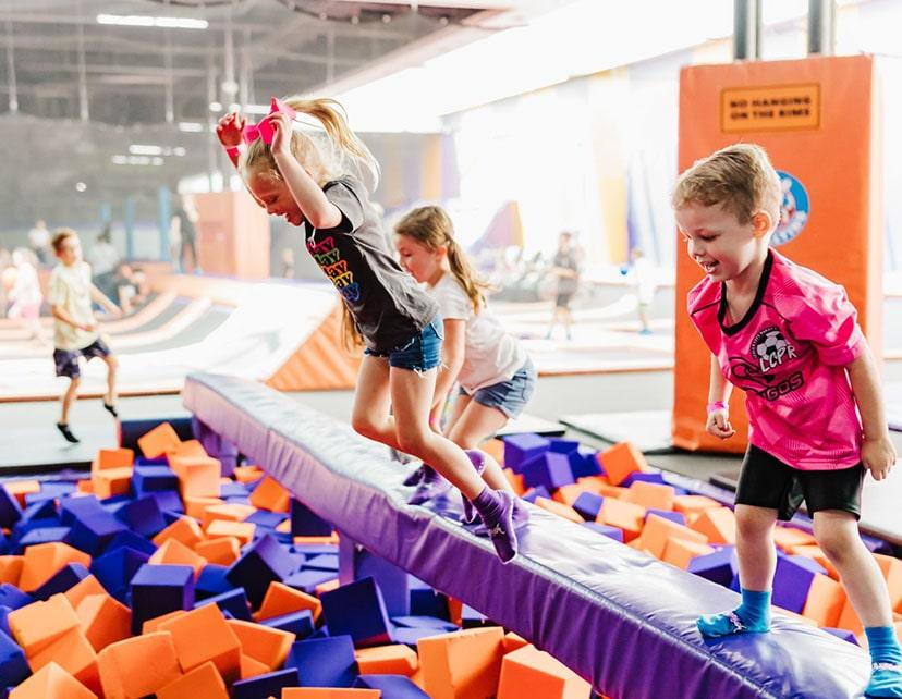 kids jumping into foam pit at tex